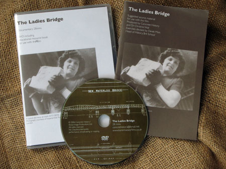 Photo of the DVD case and accompanying booklet showing woman holding large stone